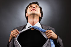 Business man tearing off his shirt Royalty Free Stock Image