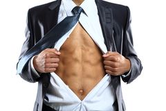Business man tears open his shirt in a super hero Stock Images