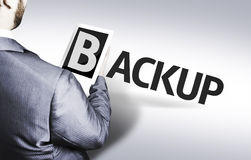Business man with the text Backup in a concept image Stock Photography