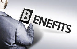 Business man with the text Benefits in a concept image Stock Images