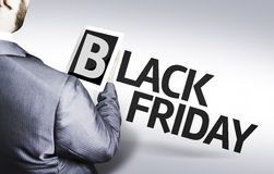 Business man with the text Black Friday in a concept image royalty free stock photos
