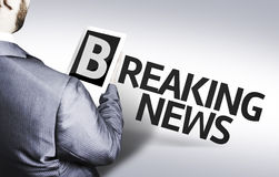 Business man with the text Breaking News in a concept image Stock Images