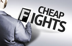 Business man with the text Cheap Fights in a concept image stock images