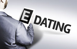 Business man with the text E-Dating in a concept image stock photos