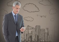 Business man texting against brown background with city doodle. Digital composite of Business man texting against brown background with city doodle Stock Photos