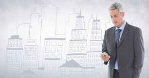 Business man texting against white wall with city doodle Stock Photography