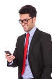 Business man texting on his phone Stock Photography