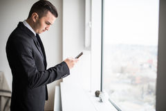 Business man texting at work. Successful business man texting at work Stock Images