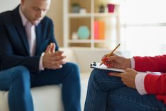 Man at therapy session stock photos