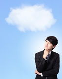 Business man thinking with cloudy sky background Royalty Free Stock Image