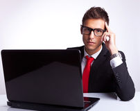 Business man thinking at desk Stock Images
