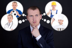 Business man thinking or dreaming about his future over dark bac Royalty Free Stock Photo