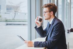 Career opportunity, business man thinking and drinking coffee royalty free stock photo