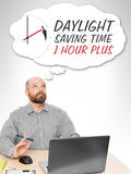 Business man thinking. An image of a handsome business man thinking about the daylight saving time Royalty Free Stock Image