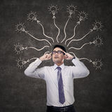 Business man thinking many ideas Stock Photo