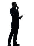 Business man  thinking pensive digital tablet  silhouette Stock Images