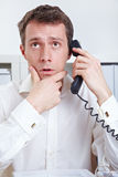 Business man thinking on phone Royalty Free Stock Photo
