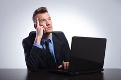 Business man thinks behind laptop Royalty Free Stock Photography