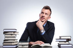 Business man thinks while reading Royalty Free Stock Images