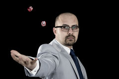 Business man throwing dice up in the air Royalty Free Stock Image