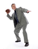 Business Man Throwing a Football. A business man aims for success with possitive direction royalty free stock photos