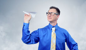 A business man throwing a paper plane Stock Photos