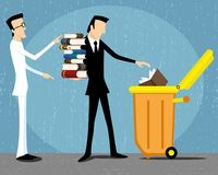 Business man throws books. Business man throws books into the garbage can Royalty Free Stock Image