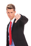 Business man with thumb down Stock Images