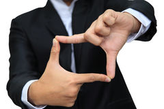 Business man thumb and forefinger connect Stock Photo