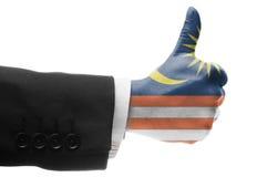 Business man thumb up with Malaysian flag Stock Photos