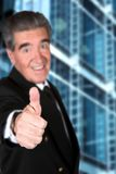 Business man thumbs up Stock Images