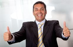 Business man with thumbs up Stock Photos