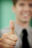 Business Man thumbs up. Business Man puts his thumb up in approval Royalty Free Stock Image
