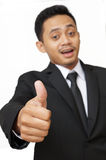 Business man with thumbs up, focus on hand. Isolated over white background stock photo