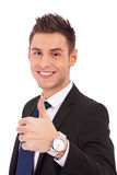 Business man with thumbs up gesture. Happy smiling business man with thumbs up gesture, isolated on white background royalty free stock photos