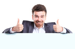 Business man with thumbs up gesture presenting. Happy business man with thumbs up gesture presenting and showing with copy space for your text isolated on white stock photos