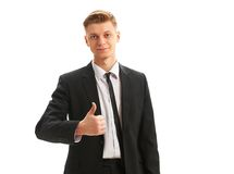 Business man thumbs up over a white background. Young business man thumbs up isolated on white background royalty free stock photos