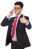 Business man thumbs up at the phone Stock Photos