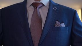 Business man tidy up his suit's button, makes a stock footage