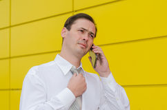 The business man in a tie speaks by phone Stock Image