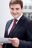 Business man with tie and suit with documents Stock Photography