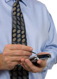 Business man with tie using PDA - calendar Stock Photo