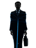Business man tied up prisoner silhouette Royalty Free Stock Photos