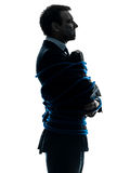 Business man tied up prisoner silhouette Royalty Free Stock Images
