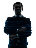 Business man tied up prisoner silhouette Stock Image