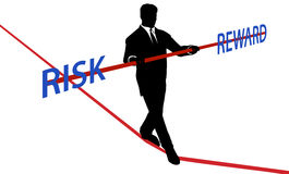 Business man tightrope balance RISK REWARD. Business man walks tightrope to balance RISK REWARD Stock Photo