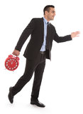 Business man in time: walking to the right holding clock isolate Royalty Free Stock Image