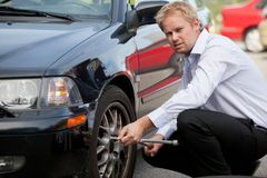 Business Man Tire Change Stock Photo