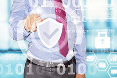 Business man touch data security interface. Business man touching data security interface Stock Photo