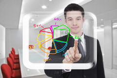Business man touch graph screen Stock Photos